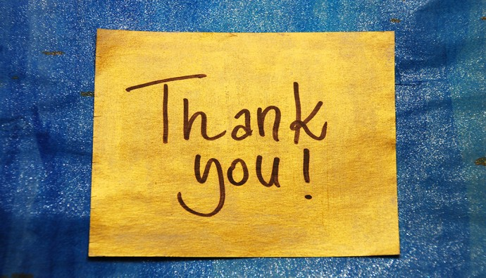 thank you message handwritten on gold sticker